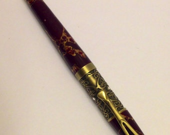 Filibella twist pen made from Antique Brass and