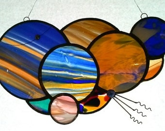 Contemporary and high quality unique stained glass panel.  Made with a variety of techniques, and a fun and funky design.