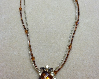 Vintage 1940s amber brooch on beaded necklace.