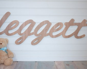 Alternative wedding guest book Personalized nursery name above a crib