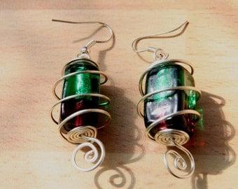 Lampwork Earrings. Silver spiral wire earrings encasing a green and maroon bead Freeform design. Art jewellery.