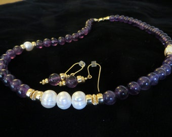 Amethyst necklace and earring set with baroque pearl stations.