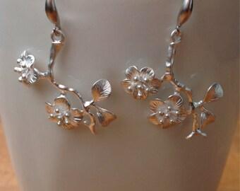 Matte silver flower branch pendant on fancy french earwires