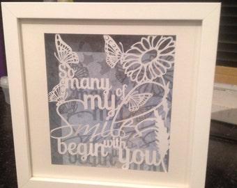 Smiles-completely handcut papercut artwork, framed original design