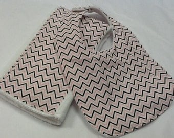 Baby bib and burp cloth set in pink and brown chevron
