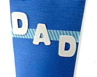Handmade blue Fathers' Day card, wooden word Dad.