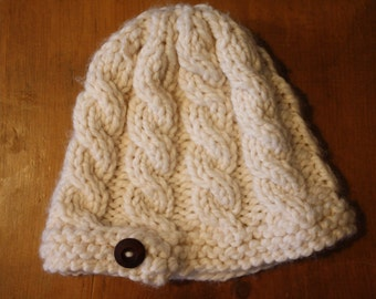 Hand-made cable-knit hat with wood side button