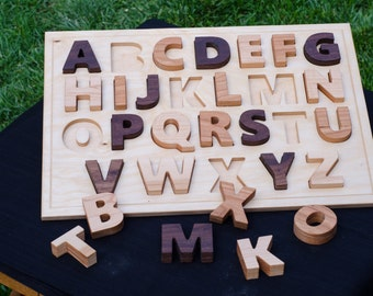 Wooden ABC's Puzzle, easy for little hands to grip and learn.