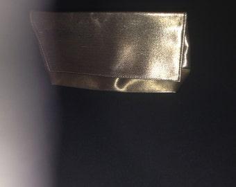 hot 80's gold metallic clutch or makeup bag (vintage)