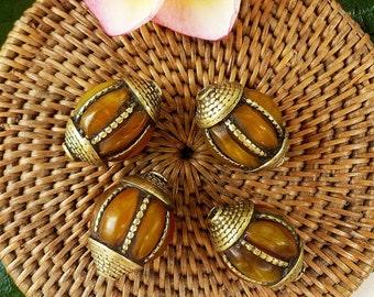 Four Tibetan Brass Beads