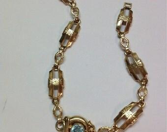 1950's 10k gold link bracelet with synthetic blue topaz maker Esemco