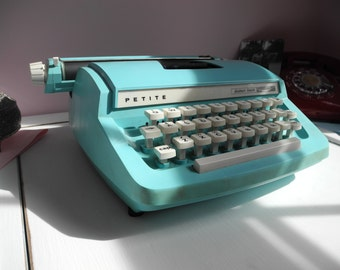 Petite feather touch typewriter- made in England