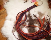 """ON SALE Long 20"""" vegan suede flogger with orange and purple tails with a cute Halloween theme"""