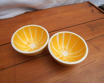 pair of orange bowls