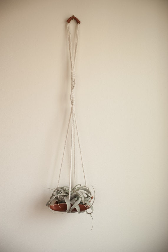 Items similar to Macrame and leather plant hanger on Etsy