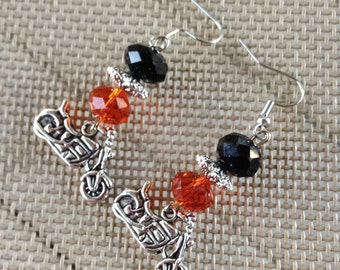 Motorcycle earrings in antique silver with orange and black beads.