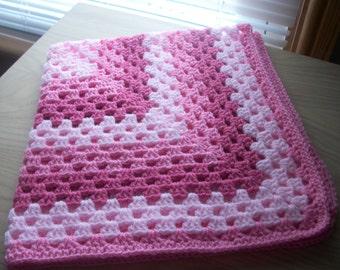 Pretty baby pram blanket in three shades of pink.