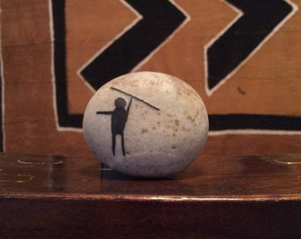 Neanderthal on natural, polished river stone.