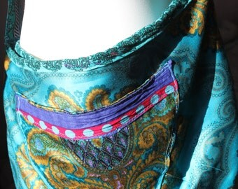Blue slouch bag made from antique fabric