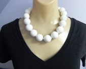 White necklace with large, lightweight round beads