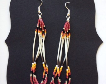 Porcupine quill earrings-red-Native American hangs 2.5 inches. Sterling Silver Hooks.