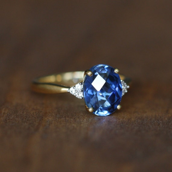 Oval Sapphire Solitaire Engagement Ring In 10k Yellow Gold