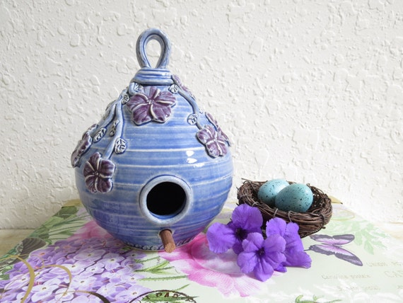Ceramic Birdhouse Covered in Purple Flowers and Vines