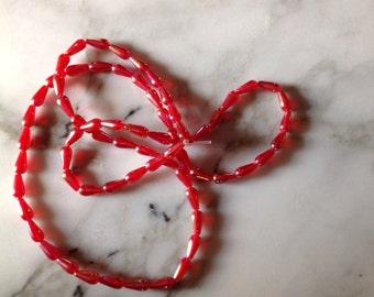 Light Red AB Teardrop Beads, 12 mm x 7mm, full strand, 34 inches. Destash.