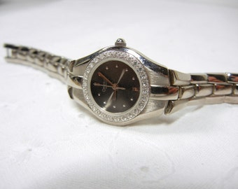 Caravelle by Bulova Watch / Vintage diamond watch / water resistant / black face / stainless steel back / silver / Mothers Day / gift