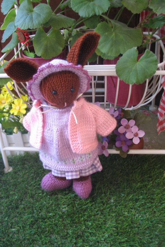 Lilly Bunnykin    Handknitted bunny rabbit   Comes with a pink cardigan  I am sorry but I could not make her any sweeter!