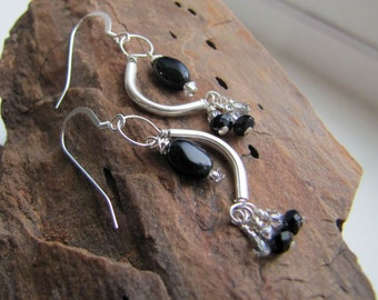 black onyx earrings . HEARTBEAT . Hill Tribe earrings . black earrings . silver earrings . curved earrings . funky statement earrings . love