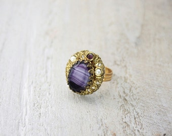 Ring recycled  vintage. Gold tone and adjustable.  Beautiful and one of a kind.