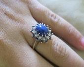 14K White gold sapphire and diamonds ring.