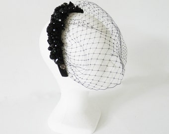 Illustrious black aliceband with birdcage veil and countless beads