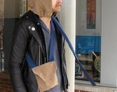 Drawstrap Hood - unisex tan head covering with topstitching texture, blue drawstring strap, matching pouch