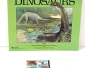 Dinosaur Postage Stamp Dinosaur Calendar The Land Before Time movie  90s T Rex Pteranodon Museum of Natural History Vintage FREE US Ship