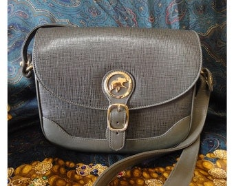 Vintage Hunting World khaki genuine leather shoulder purse with iconic gold tone elephant logo charm at front
