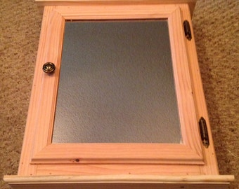 Made to order handmade single door medicine cabinet.