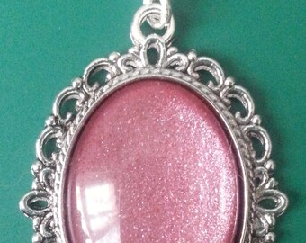 Gorgeous pink slightly glittery glass pendant with silver chain