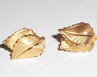 Giovanni earrings  clip on backs double leaf  brushed gold tone metal leaves 1960s vintage jewelry