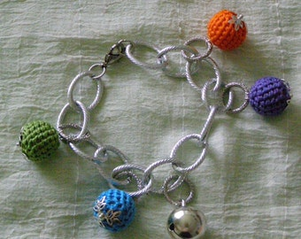 Colored bracelet with charms