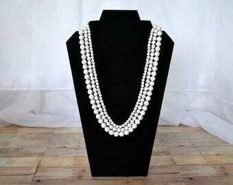 Triple stranded white beaded necklace w/ rhinestone clasp