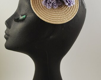 2 BRÉTEMA: base of straw, fabric flowers, and feathers of ostrich and goose biot