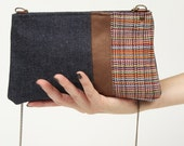 Small shoulder bag combined with blue denim, brown suede and colorful upholstery.  Purse  TINY2