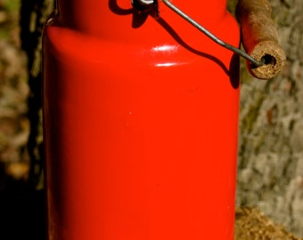 Vintage red enamel milk can