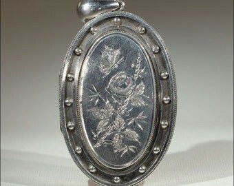 Antique Victorian Silver Locket with Butterfly and Flower Motif, Hallmarked 1880
