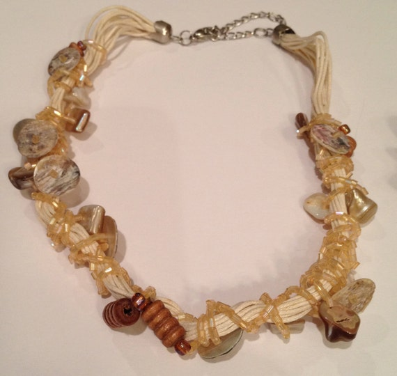 Shell, buttons, beads and multi-threads off-white necklace