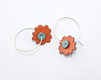 Reversible enamel flower earrings; bright peachy-melon reverses to teal blue with sky blue centers on sterling silver hoops