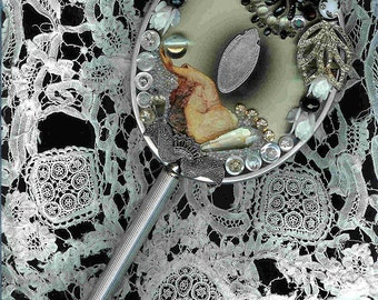 Silver and Black Duet ~ Antique hand mirror with gorgeous added embellishment