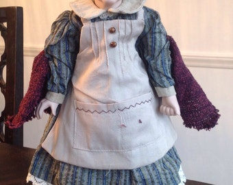 What kinds of collectible dolls does Duck House Dolls make?